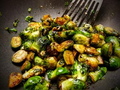 Brussels sprouts in pan with spatchula