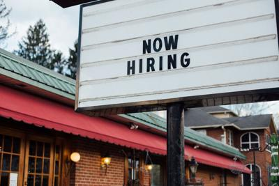Now hiring sign on outdoor marquee