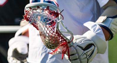 Close-up of a male lacrosse player holding his stick.