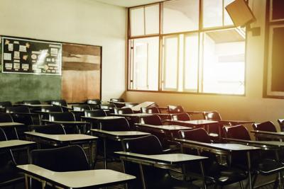 Empty classroom with sunlight coming in window