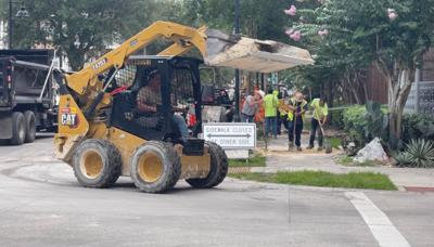 City workers implement roadway changes