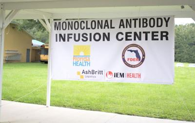 Banner marking monoclonal antibody infusion center in High Springs