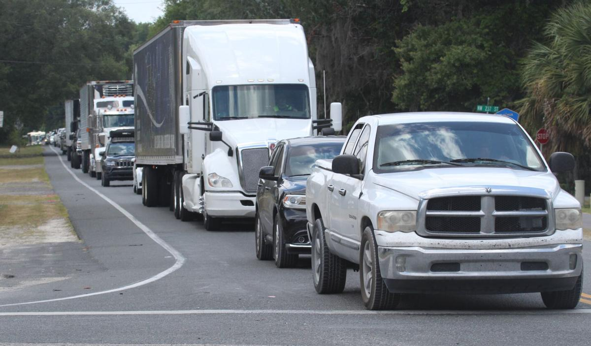 Vehicles lines up on Poe Springs Road CR 340