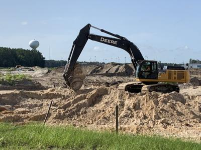 A backhoe works at a development adjacent to the Easton-Newberry Sports Complex