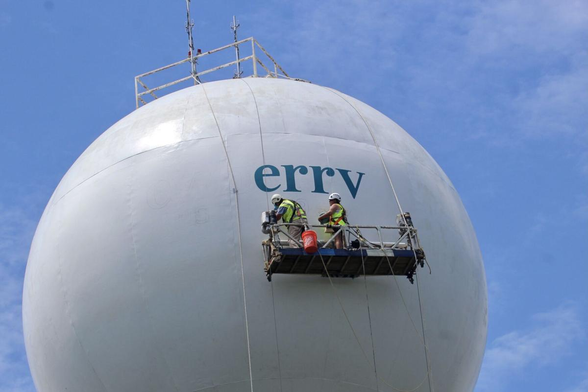 Newberry water tower with painters at work