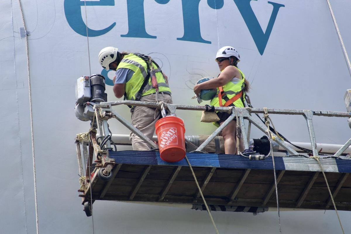 Jimmy and Cathy Kelly painting Newberry water tower