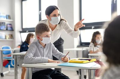 Teacher and student during pandemic