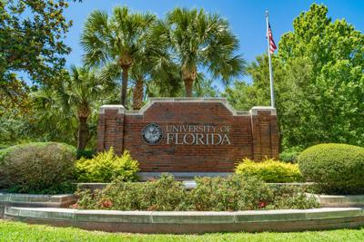 University of Florida brick sign with American flag