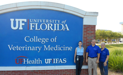Eileen Roy-Zokan, Jason Byrd and Ginger Clark beside IFAS sign