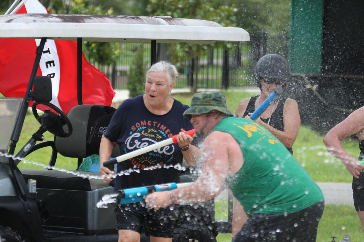Water wars with squirt guns at Williston Crossings RV Resort