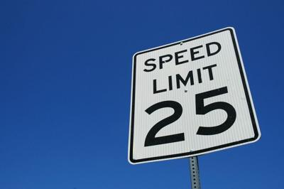 Speed limit 25 sign against blue sky background