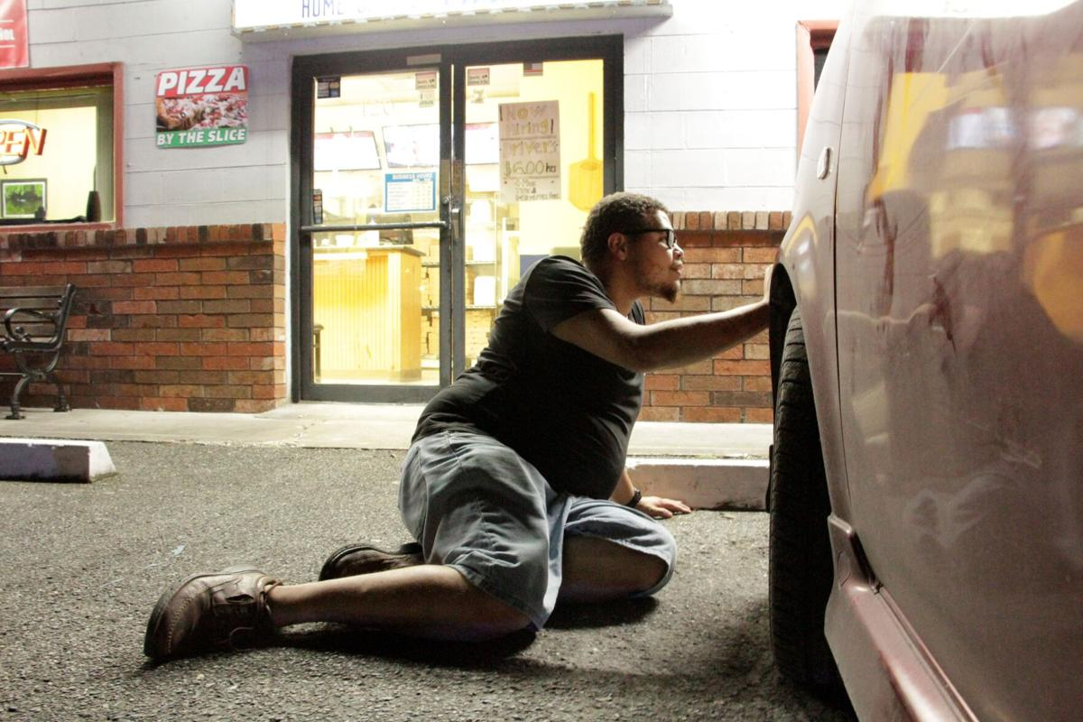 Newberry Pizza employee hides from shooter behind car