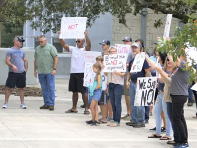 Protesters rally in downtown Gainesville against the city's COVID-19 vaccine mandate