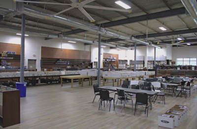 Mega Gaming & Comics floor space with tables, chairs, boxes