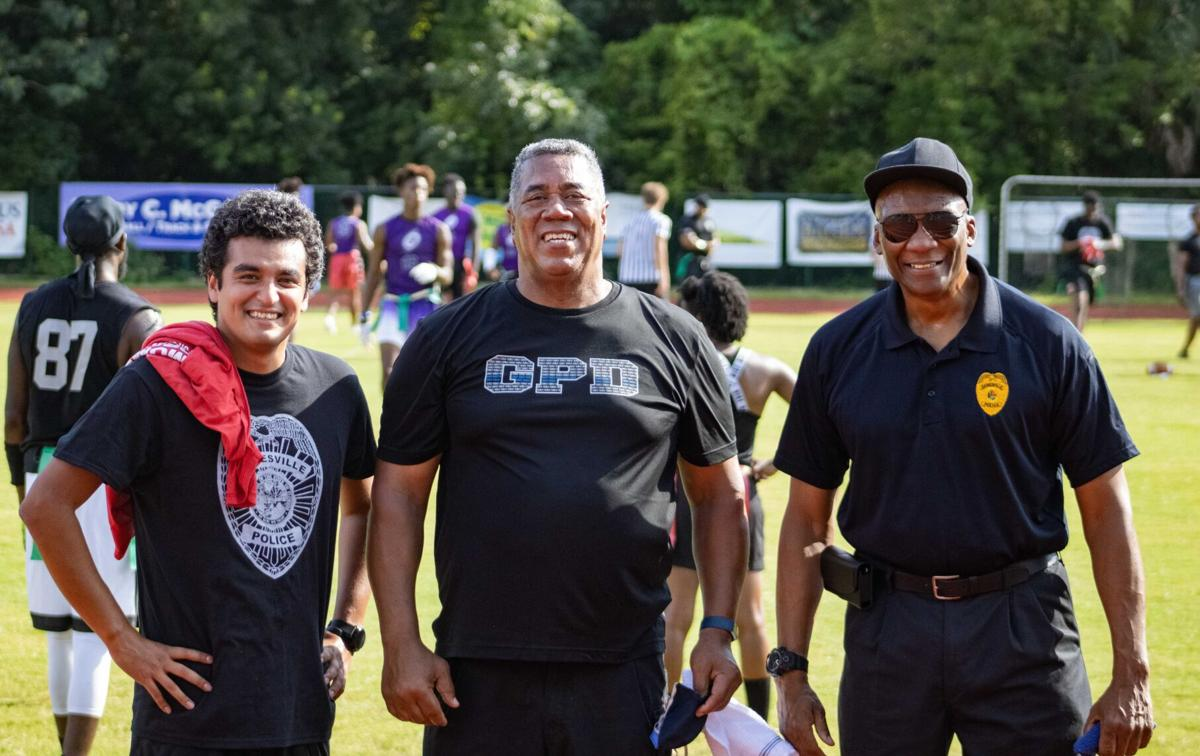Commissioner David Arreola, Assistant Chief of Police Lonnie Scott, and Chief of Police Tony Jones