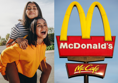 Two girls hanging out and a McDonalds sign