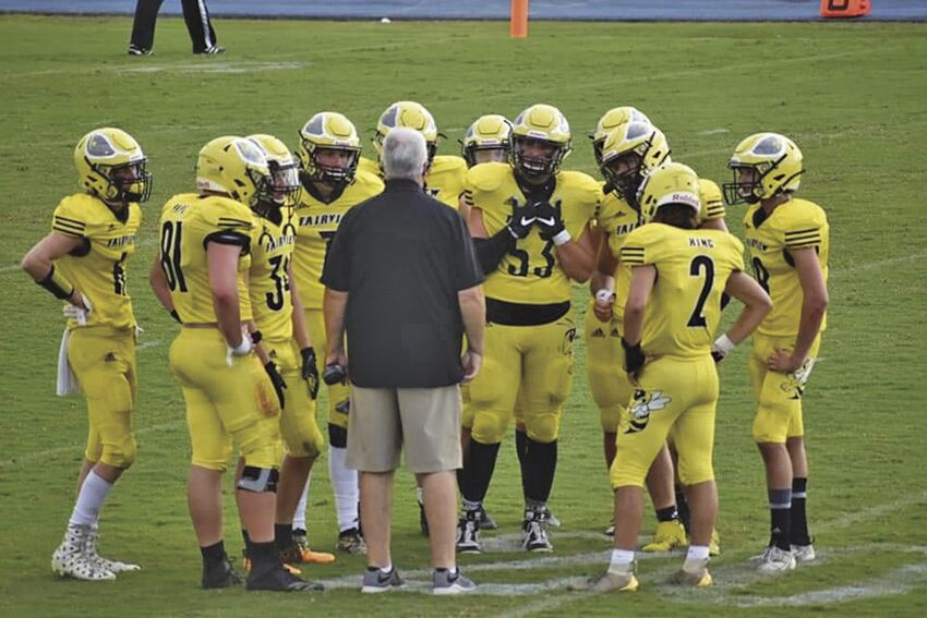 FHS Brian Kuhn on the field with Yellow Jackets 2020
