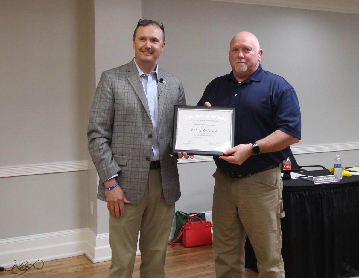 Redmon earns Certificate of Achievement
