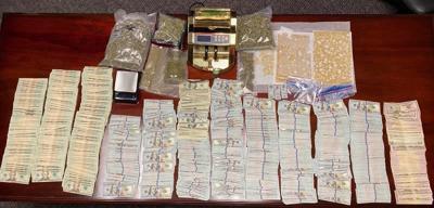 Cash, drugs seized