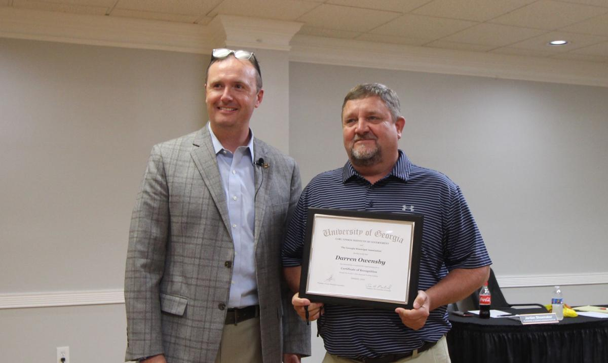 Owensby receives Certificate of Recognition