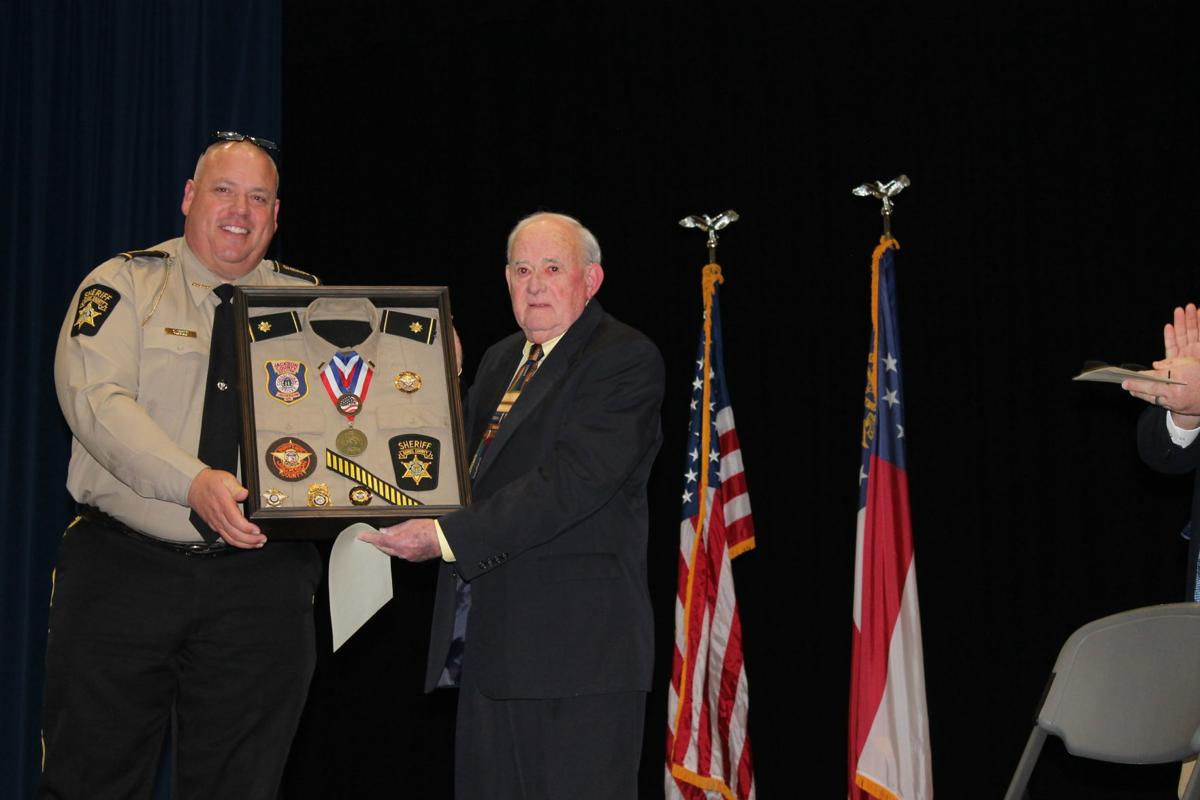 PRESENTED WITH SHADOW BOX