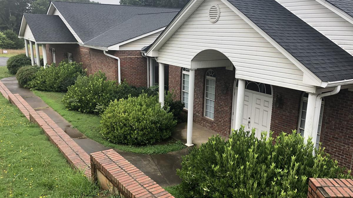 County purchases old funeral home
