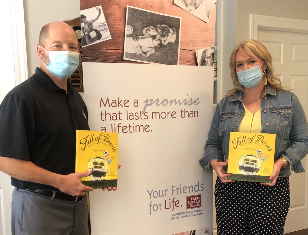 Farm Bureau Ted-Staci donating ES book Aug. 2020.png