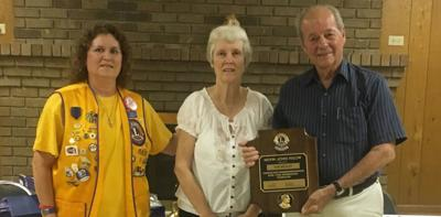 Mosleys presented award from Comer Lions Club