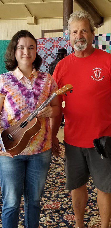 Lee wins ukulele at bluegrass festival