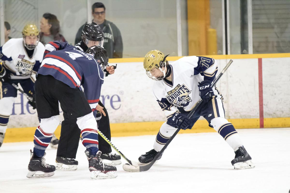 Connor Bennett (71) takes a faceoff for JPII.jpg