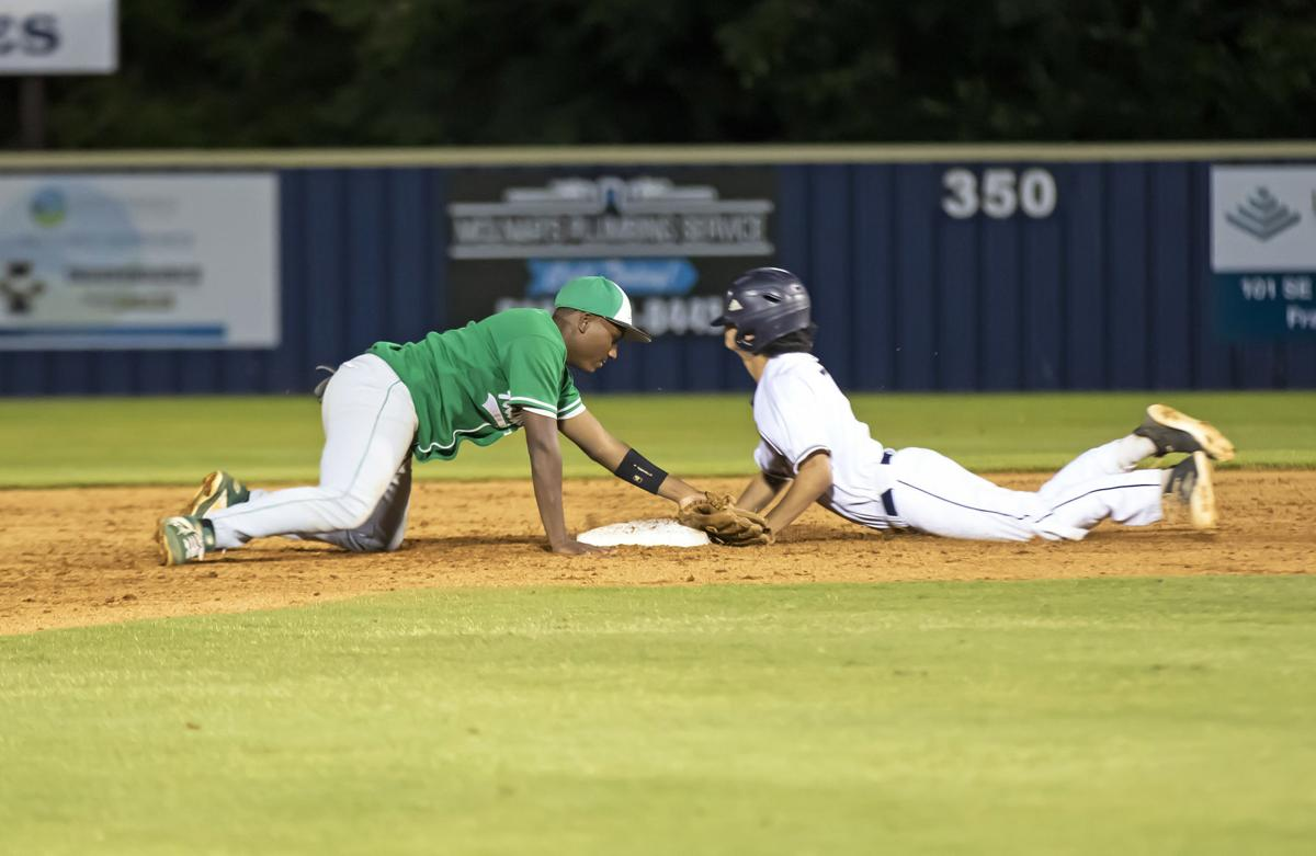 Hillwood's Darrell Holt (left) dives but can't tag Indy's Alex Chen (right).jpg