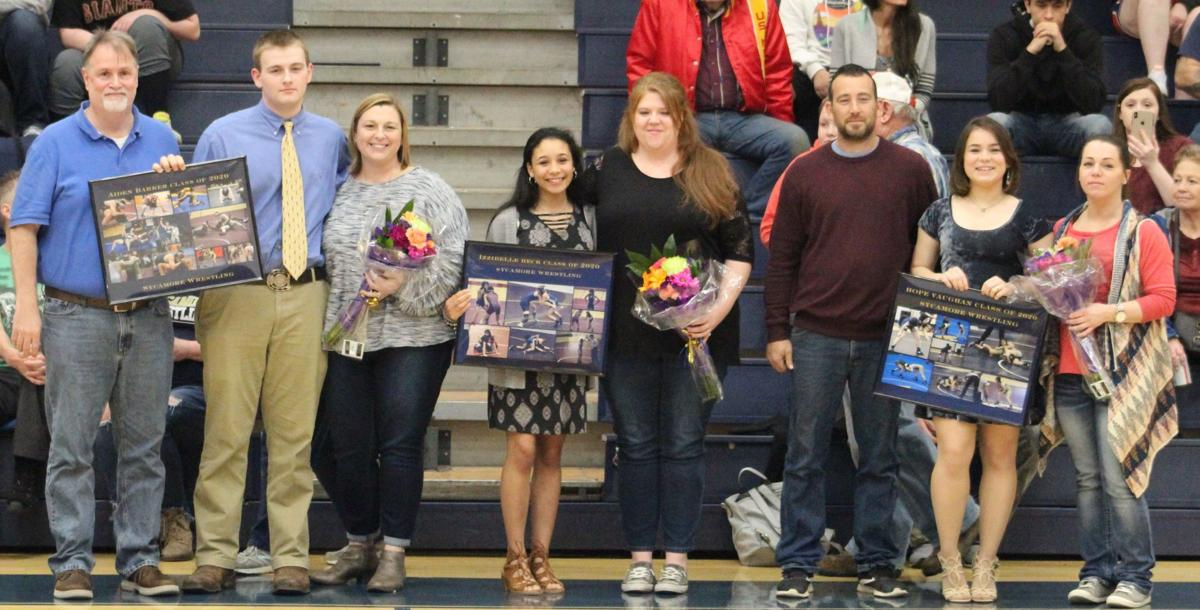 All three Sycamore seniors with their families.JPG