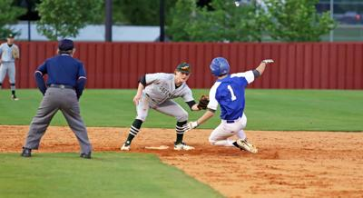 Greenbrier's Stoney Smith (left) prepares to tag out MLK's Baron Patterson at second
