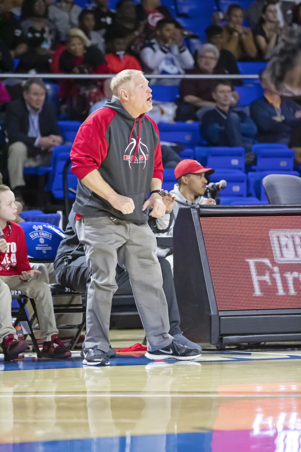 East Nashville coach Jim Fey yells out a play for the Eagles on the floor.jpg