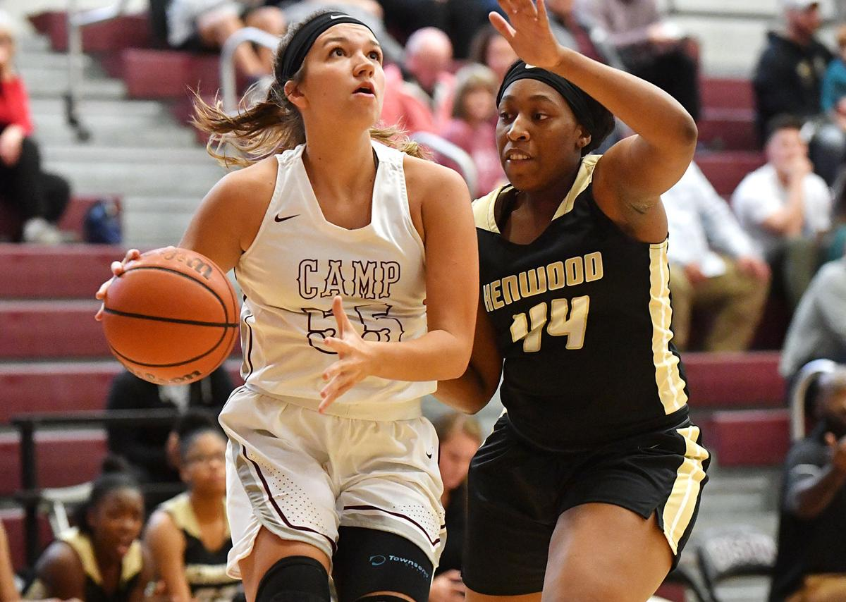 Faith Eubank scored a game-high 19 points against Kenwood. Lady Knight defender Nevaeh Thorpe closes in on the low block..jpg