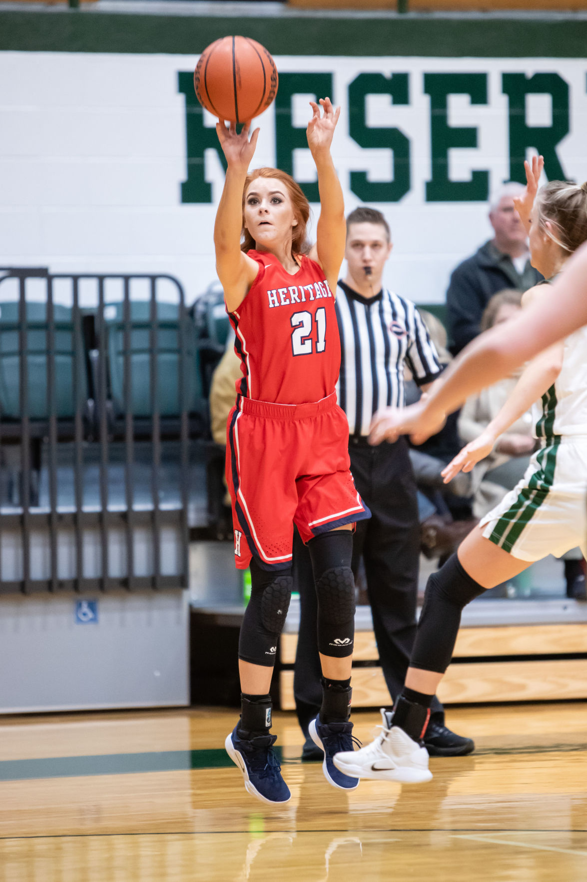 WH Heritage's Kelsey Russell shoots a 3-pointer.JPG