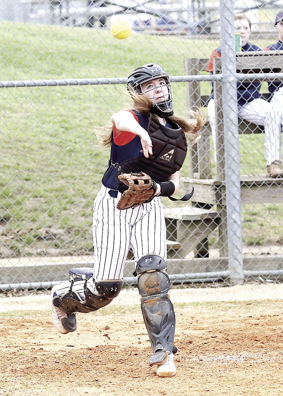 Dickson County catcher Olivia Littleton throws out a runner at first base at the Waverly Diamond Classic. MARTY ALLISON/DICKSON SPORTS MEDIA