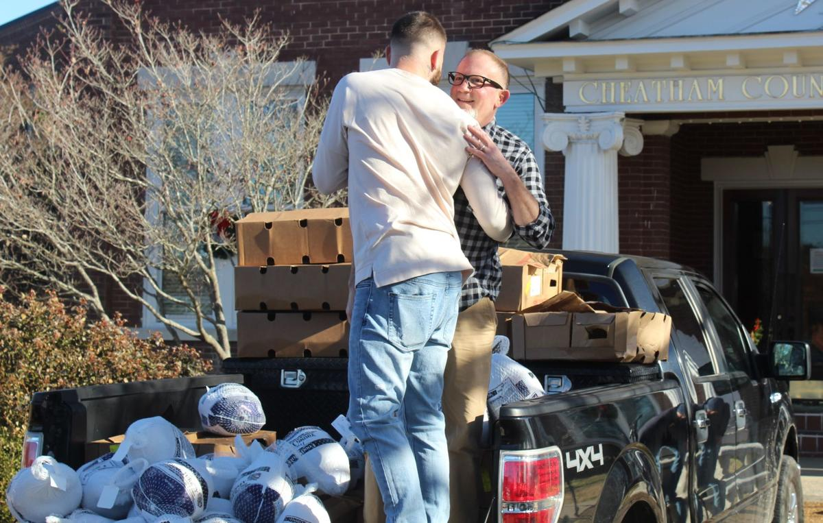 Caleb Plant, along with his father Richie, handed out the turkeys.JPG