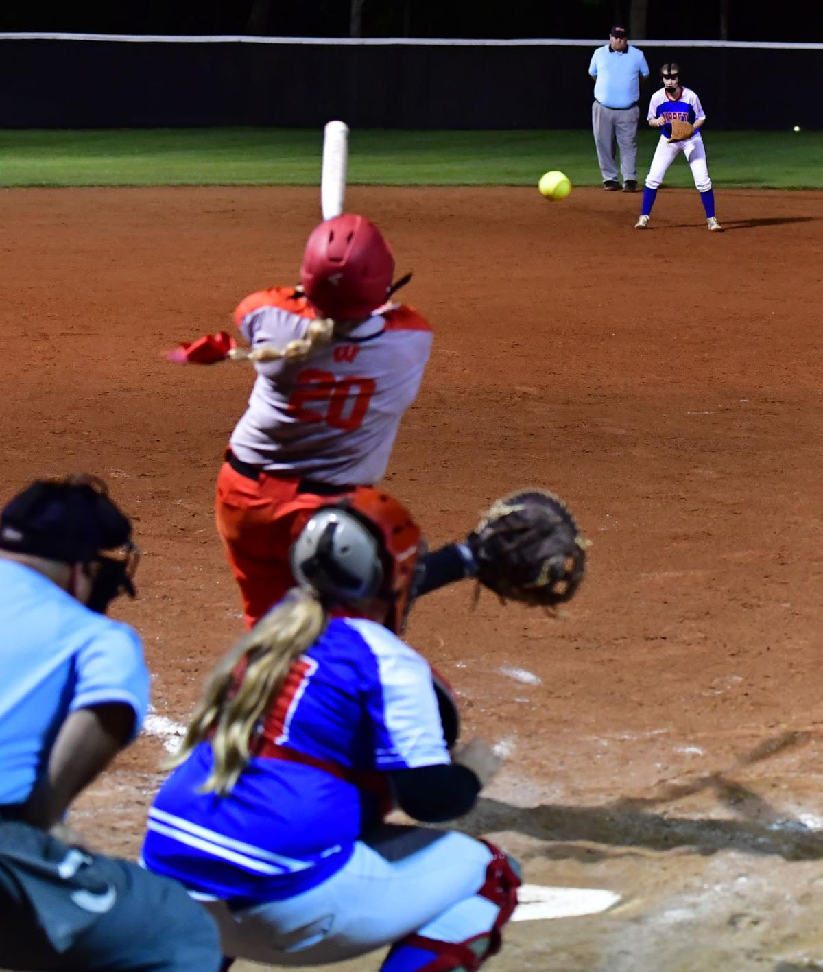Westmoreland's Aubree Presley (20) hits a ball to Harpeth shortstop Ashley Russell.