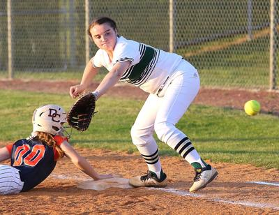 Independence first baseman Olivia Shearer fields a throw while making a play on Dickson County's Becca Lee