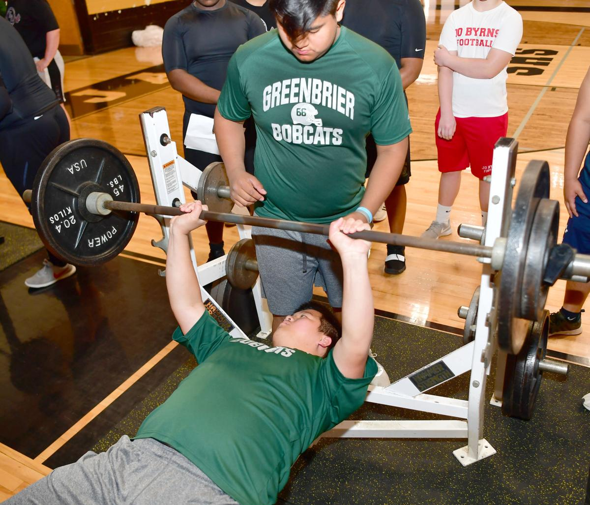 Yonathon Rivera spots for Greenbrier teammate Andy Li. Li won the 260+ lb. class.