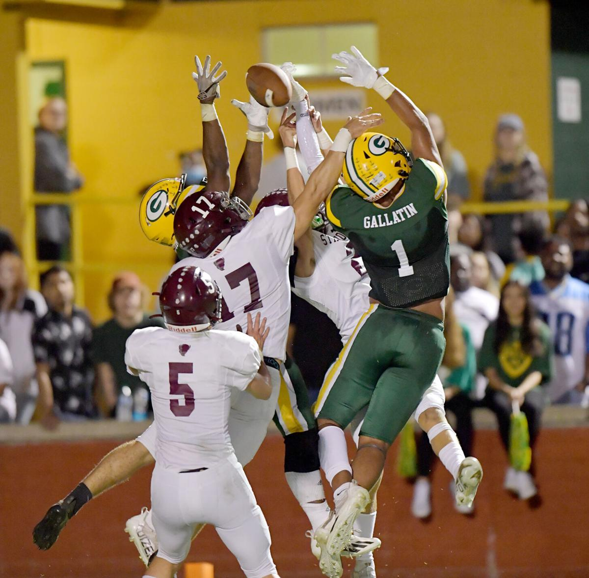 A Green Wave pass falls incomplete as DJ Rogers (1), Christian Pentecost (17) and others compete for the football. .jpg