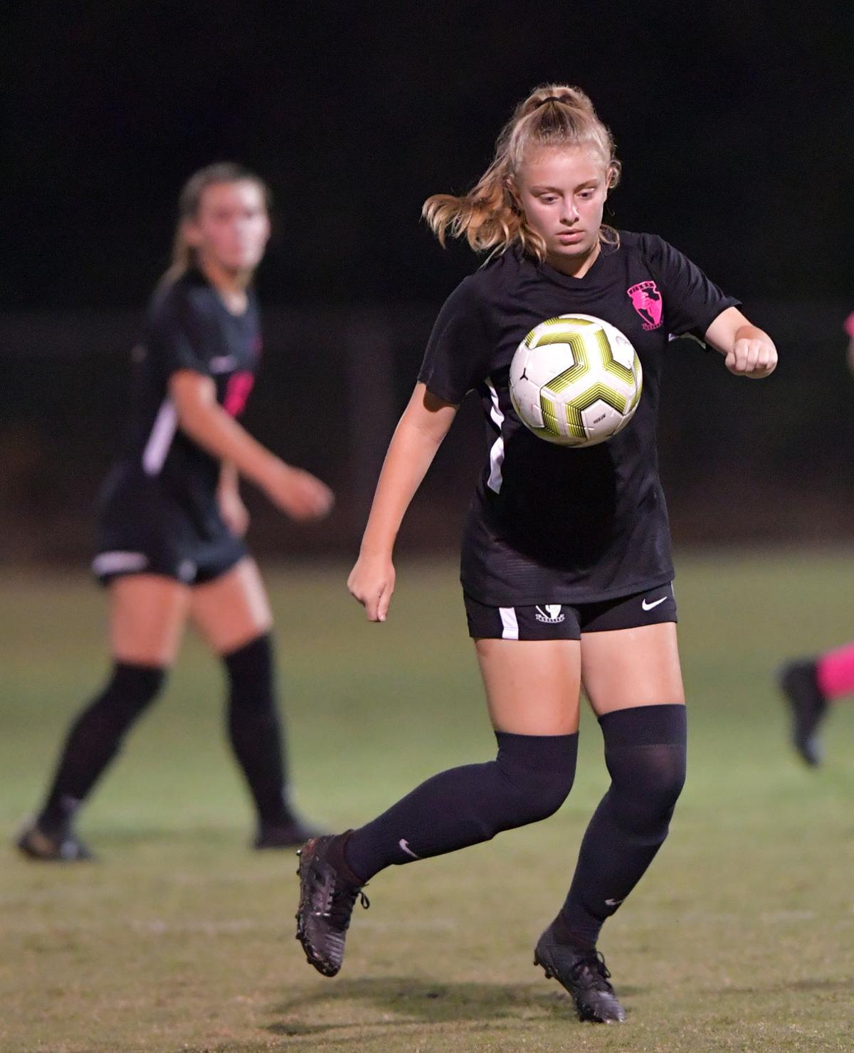 Briley Hitt watches a ball closely before gathering possession. .jpg