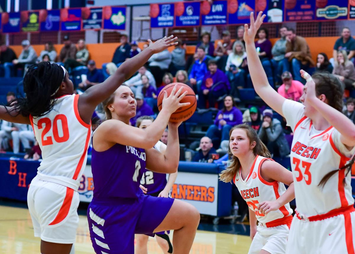 Abbie Tomlinson gets into the teeth of the Beech defense and is surrounded on her shot. .jpg