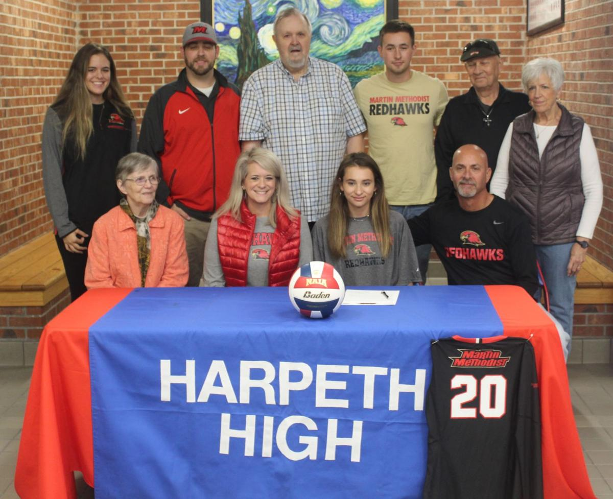 Olivia Cox with new family and new coaches.JPG