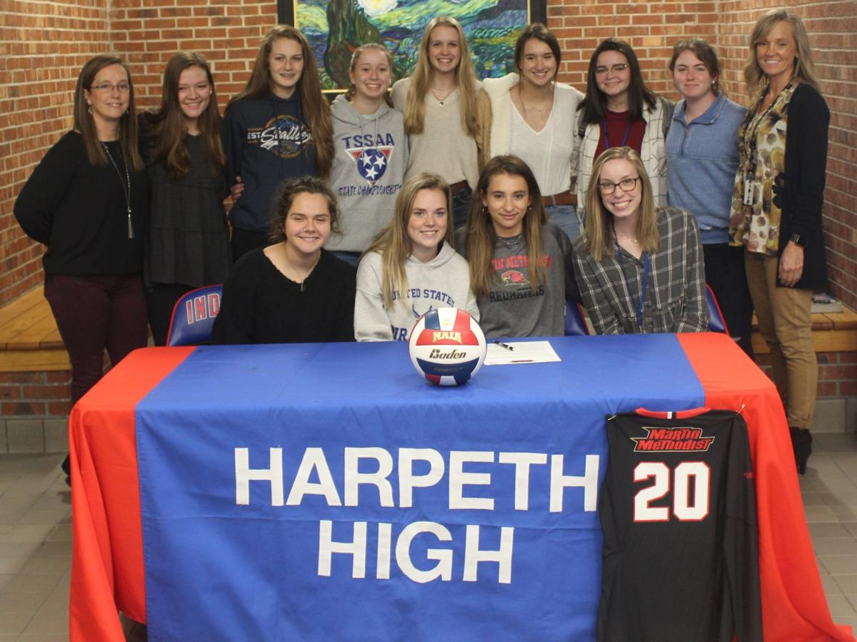 Olivia Cox with her team and coaches.JPG