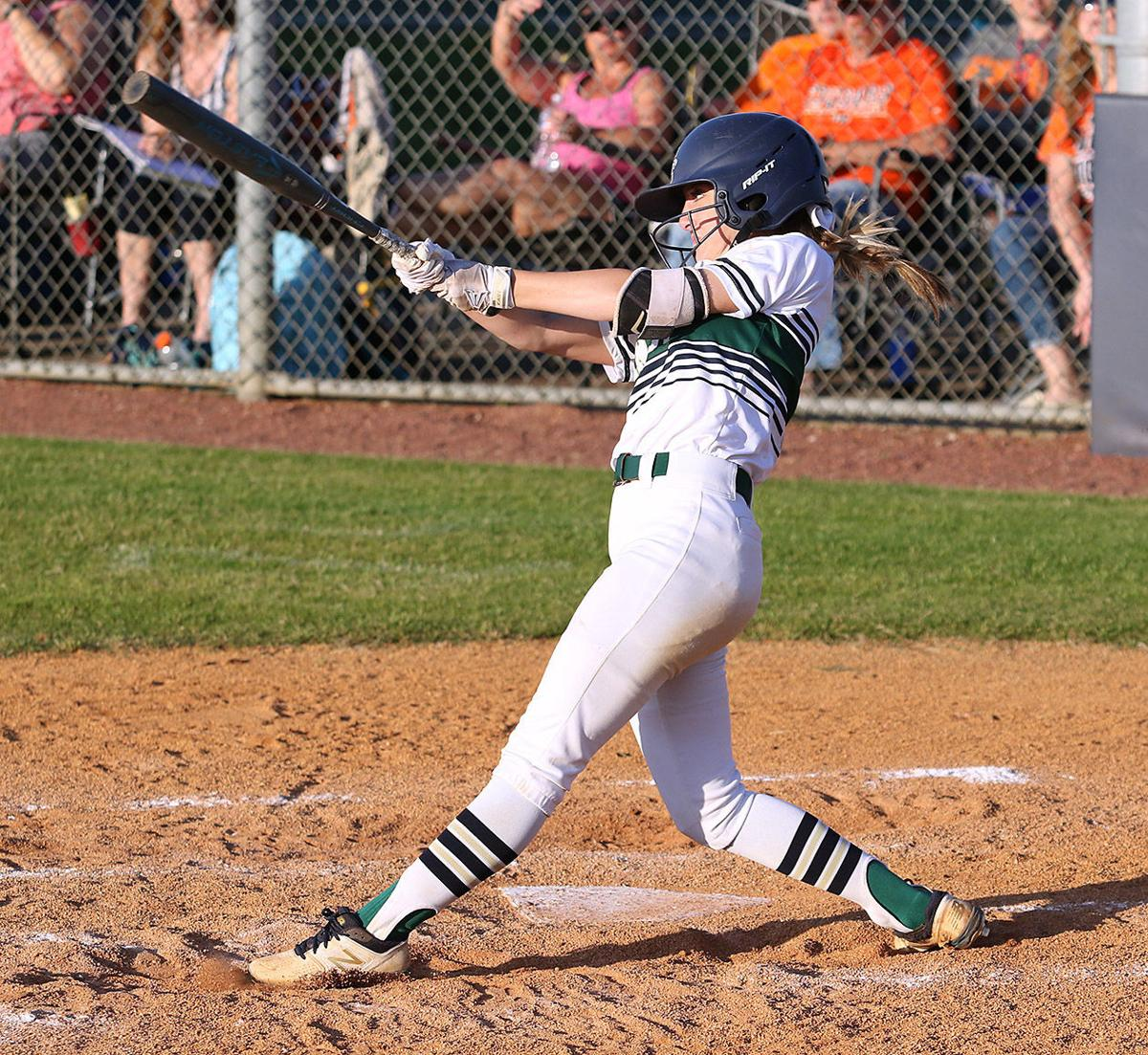 Independence outfielder Lauren Pinckard takes a big swing against Dickson County.jpg
