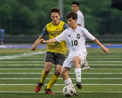 Sycamore's Cameron Johnson (10) keeps the ball away from a Fairview defender. JOSEPH SUMMERS