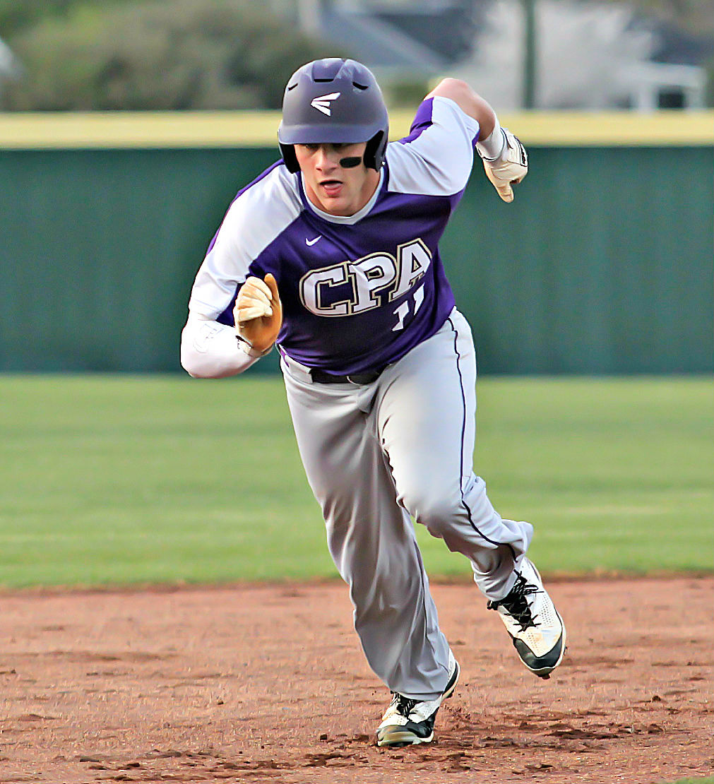 CPA centerfielder Kane Patterson digs for third base in Thursday's 8-6 win at Lebanon High. TOMMY BRYAN.jpg