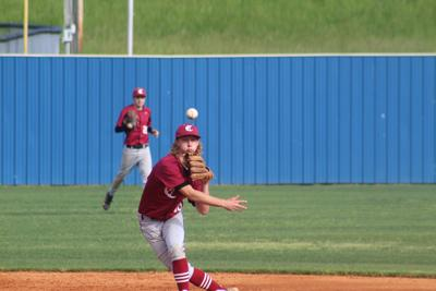 Cheatham's Sam Baker throws out a runner at first base against Westmoreland. CASEY PATRICK